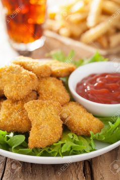 36063250-fast-food-chicken-nuggets-with-ketchup-french-fries-cola-Stock-Photo.jpg